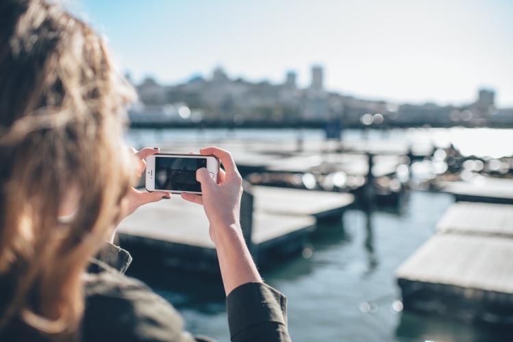 Girl Phone Picture Docks_Ian Schneider_Stocksnap