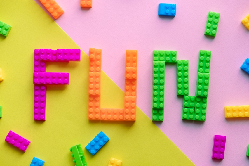 Fun spelled word with plastic blocks background